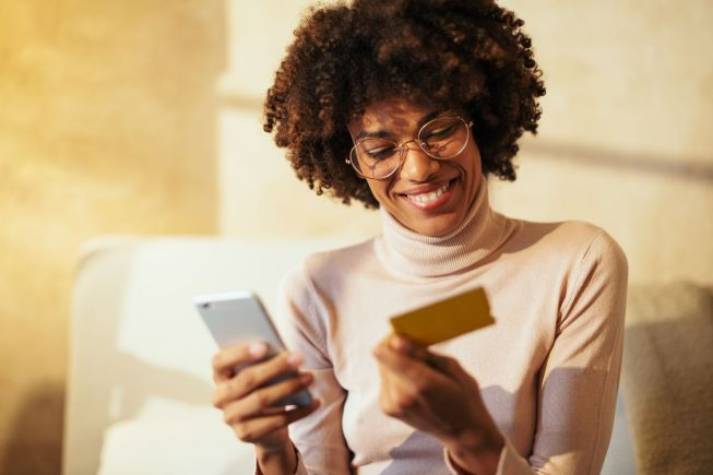 Woman shopping online with phone.
