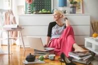 Fashion blogger writing a new blog post at home.