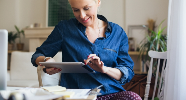 Caucasian businesswoman using a digital tablet at her office.