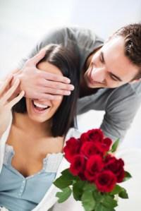 Boyfriend giving his girlfriend a Valentine's present.