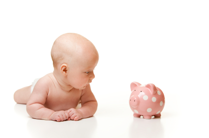 A Cute Baby Looking at Piggy Bank