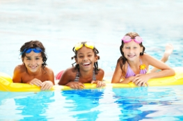 Smiling children in pool.