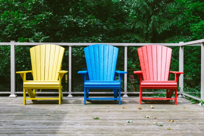 Adirondack chairs outside on the deck.
