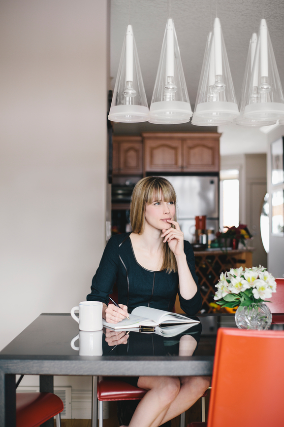 A beautiful woman thinking at the dining room table