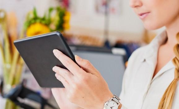 Shop assistant working on digital tablet