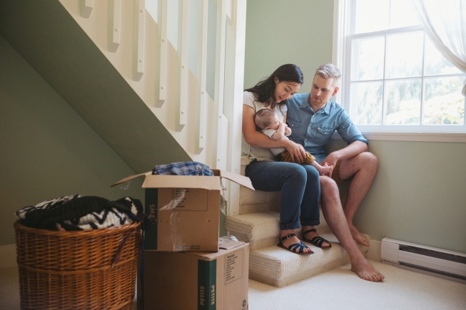 Young family taking a break from moving houses