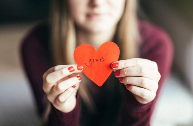 Girl holding giving heart