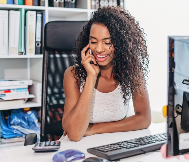 African American Woman Businesswoman on the Phone at the Office