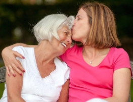 senior mother and mature daughter sharing an affectionate moment together