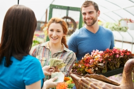 Extensive series with shoppers and growers in a plant or flower nursery.  Multi-ethnic group includes Caucasians and Asian Americans.