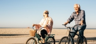 Seniors biking on the beach