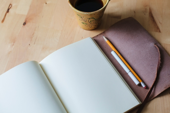 A healthier approach to the writer's life: black coffee, pencil, e-cigarette and a blank page.