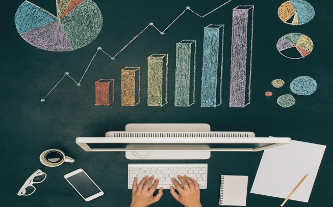 Workspace With Various Charts On Chalkboard