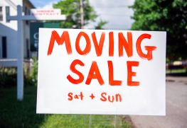 Sign in front of house announces Moving Sale