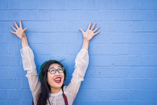 Adorable funny Asian young hipster woman with glasses.