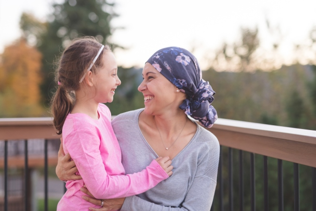Mother with Cancer Hugging Daughter