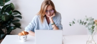 Woman filing taxes on laptop