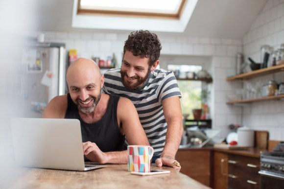 Couple using laptop to make spousal IRA contributions