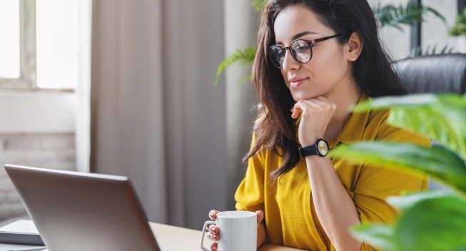 woman with coffee cup at computer