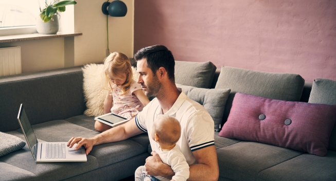 person working from home with kids